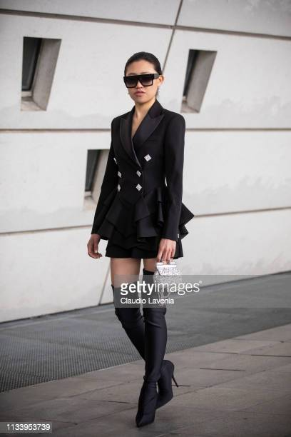 0c31007cfe Jaime Xie wearing black balzer mini bag and overknees boots is seen outside  Giambattista Valli on