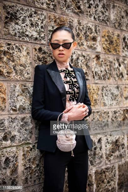 Jaime Xie wearing black blazer and pants pink shirt back Saint Laurent heels and sunglasses is seen outside Vivienne Westwood on Day 6 Paris Fashion...