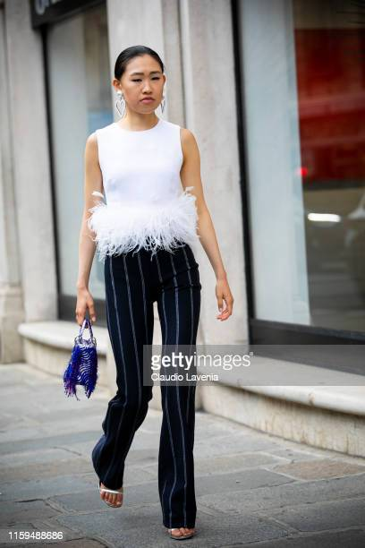 Jaime Xie wearing Prada top Dior bag and Alessandra Rich earrings is seen outside Ralph and Russo show during Paris Fashion Week Haute Couture Fall...