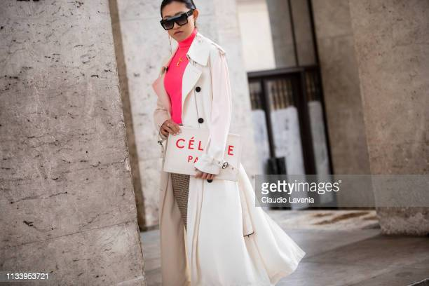 Jaime Xie wearing white coat neon pink turtleneck taupe pants and Celine  bag is seen outside c11a4efb23546
