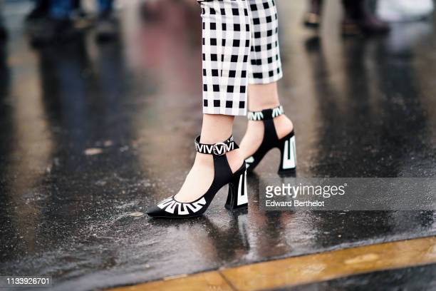 Jaime Xie wears black and white pointy anklestrapped pumps outside Chanel during Paris Fashion Week Womenswear Fall/Winter 2019/2020 on March 05 2019...