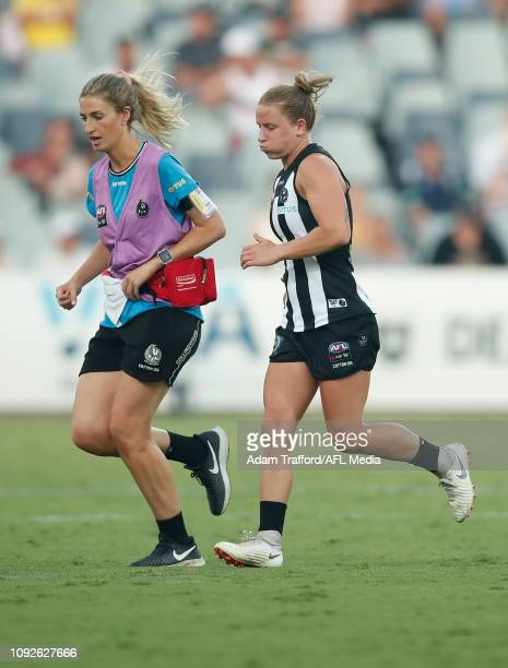 Jaimee Lambert of the Magpies leaves the field injured during the 2019 NAB AFLW Round 01 match between the Geelong Cats and the Collingwood Magpies...
