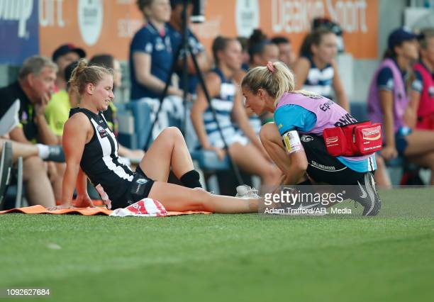 Jaimee Lambert of the Magpies receives treatment on the bench during the 2019 NAB AFLW Round 01 match between the Geelong Cats and the Collingwood...