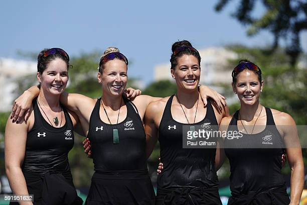 Jaimee Lovett Kayla Imrie Aimee Fisher and Caitlin Ryan of New Zealand pose for a photo following the Women's Kayak Four 500m on Day 14 of the Rio...