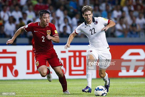 Jaimes McKee of Hong Kong vies with Ren Hang of China during a group match between China and Hong Kong as a part of 2018 FIFA World Cup qualification...