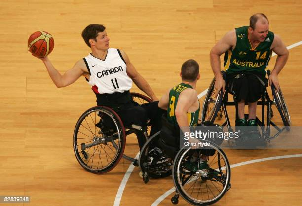 Jaimie Borisoff passes the ball durng the Gold Medal Wheelchair Basketball match between Australia and Canada at the National Indoor Stadium during...
