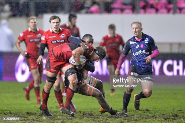Jaimie Ritchie of Edinburgh is tackled by Sekou Macalou of Stade Francais during the European Rugby Challenge Cup match between Stade Francais and...