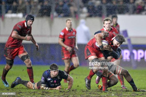 Jaimie Ritchie of Edinburgh is tackled during the European Rugby Challenge Cup match between Stade Francais and Edinburgh at Stade JeanBouin on...