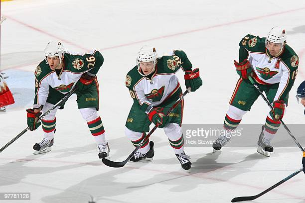 Jaimie Sifers Antti Miettinen and Andrew Brunette of the Minnesota Wild skates against the Buffalo Sabres at HSBC Arena on March 12 2010 in Buffalo...
