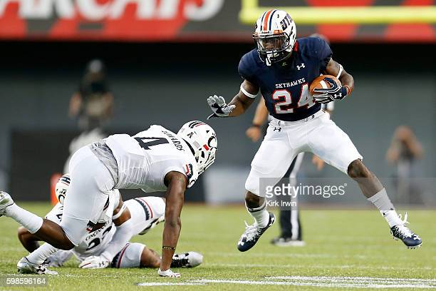 Jaimiee Bowe of the Tennessee-Martin Skyhawks stiff-arms Zach Edwards of the Cincinnati Bearcats during the second quarter at Nippert Stadium on...