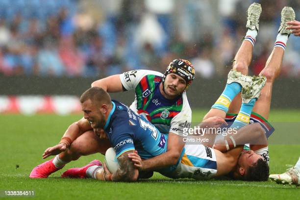 Jaimin Jolliffe of the Titans is tackled during the round 25 NRL match between the Gold Coast Titans and the New Zealand Warriors at Cbus Super...