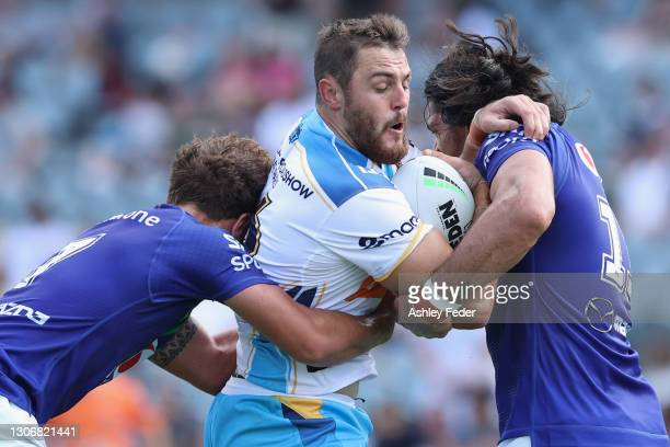 Jaimin Jolliffe of the Titans is tackled during the round one NRL match between the New Zealand Warriors and the Gold Coast Titans at Central Coast...