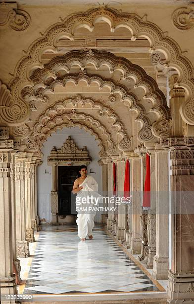 A Jain devotee visits a Hutheesing Jain temple on the last day of Parushan Parva known as Samvatsari in Ahmedabad on September 01 2011 During...