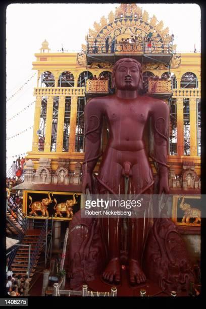 Jain devotees bathe the head of monolithic statue of Bhagwan Bahubali during the Mahamastakabhisheka ceremony December 19 1993 in Shravanabelagola...