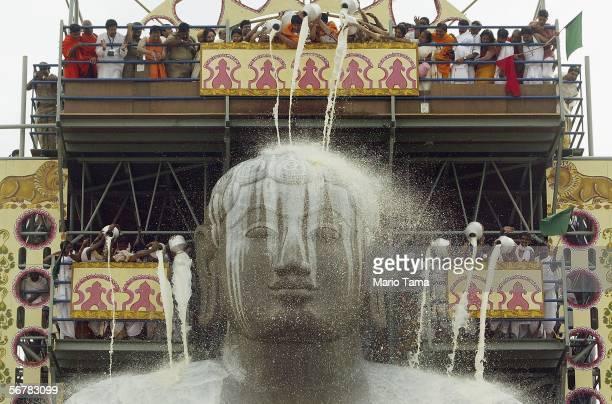 Jain devotees pour milk over the monolithic statue of Jain sage Gomateswara during the first day of the Mahamastak Abhisheka ceremony February 8 2005...
