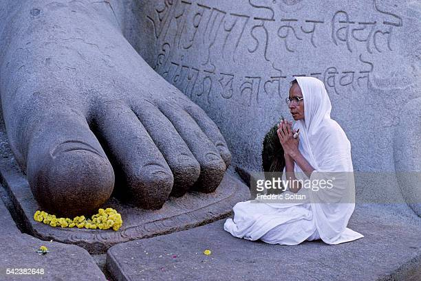 Jain nun at the foot of Lord Bahubali's statue in Sravanabelagola a great center for Jain culture