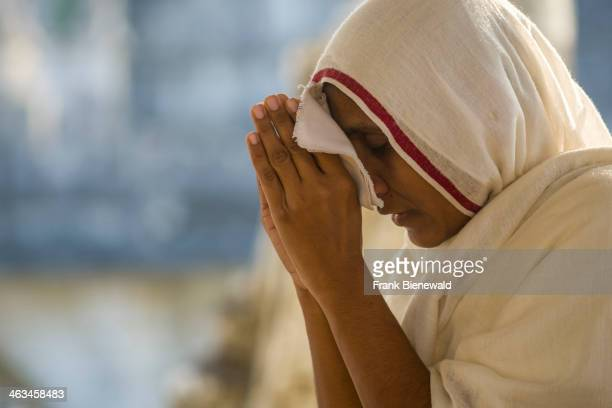 Jain nun is meditating in a temple at Shatrunjaya hill one of the major pilgrim sites for Jains on the opening day of the yatra season