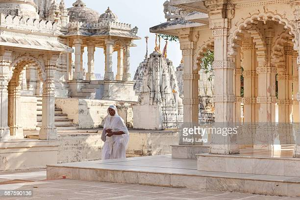 Jain nun walking in Palitana temples on Shatrunjaya hill Gujarat India