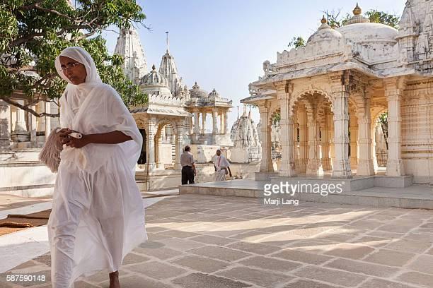 Jain nun walking in Palitana temples on Shatrunjaya hill Gujarat India