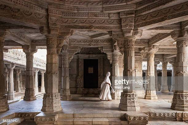 jain nun walking in white marble ranakpur temple - jain temple stock photos and pictures