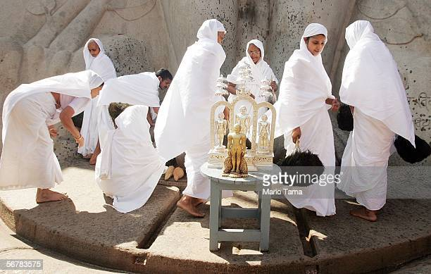 Jain nuns gather beneath the monolithic statue of Jain sage Gomateswara during the first day of the Mahamastak Abhisheka ceremony February 8 2006 in...