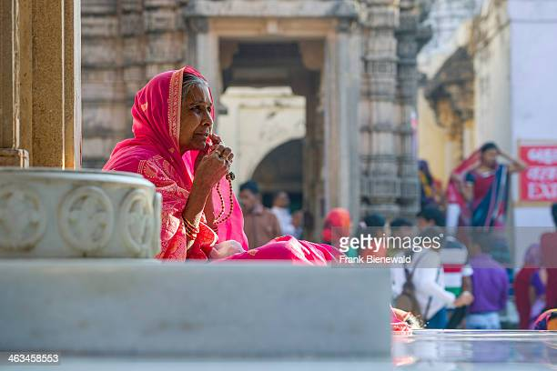 Jain pilgrim is meditating at Shatrunjaya hill one of the major pilgrim sites for Jains on the opening day of the yatra season