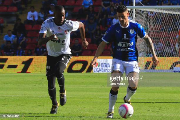 Jaine Barreiro of Atlas and Everaldo Stum of Queretaro fight for the ball during the 15th round match between Queretaro and Atlas as part of the...