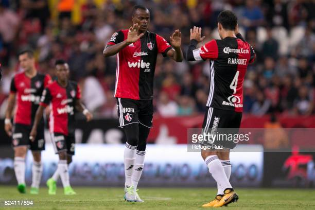 Jaine Barreiro of Atlas celebrates with teammate Rafael Márquez after scoring the first goal of his team during the 2nd round match between Atlas and...