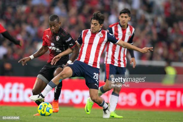 Jaine Barreiro of Atlas fights for the ball with Rodolfo Pizarro of Chivas during the 6th round match between Atlas and Chivas as part of the Torneo...