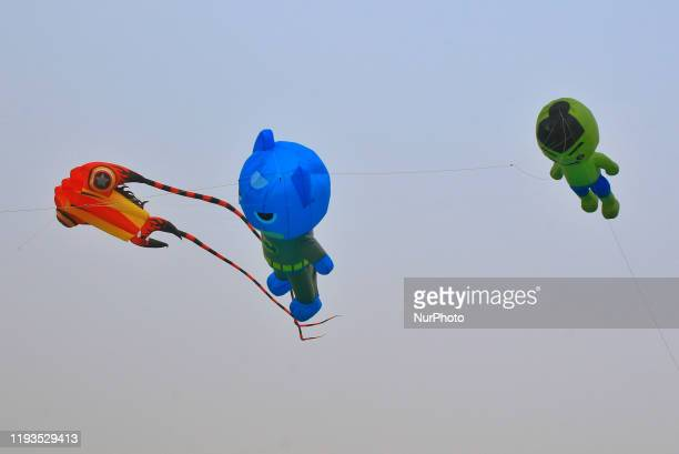 Decorative kites floats in the sky during the Kite Festival on the occasion of Makar Sakranti Festival celebration in Jaipur RajasthanIndia 13 Jan2020