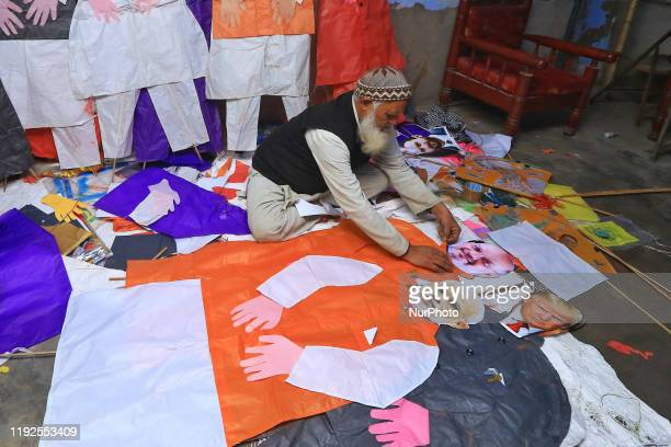 Kitemaker Abdul Gaffur Ansari makes human size kites of politicians ahead of the Makar Sakranti Festival at Handipura in Jaipur, Rajasthan,India Jan....