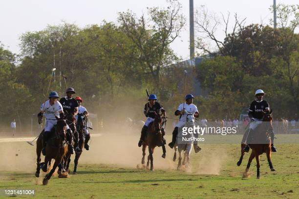 Players of Sona Polo and Chandna Group teams in action during the final polo match of 'Rajmata Gayatri Devi Memorial Cup' at Polo ground in...