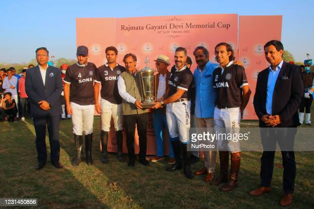 Players of Sona Polo with winner trophy after the final polo match of 'Rajmata Gayatri Devi Memorial Cup' at Polo ground in Jaipur,Rajasthan,India,...