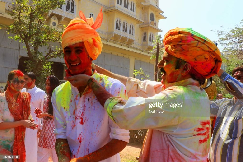 Jaipur's Maharaja Sawai Padmanabh Singh with his father Narendra Singh celebrating Holi Festival at City Palace in Jaipur, Rajasthan , India on 13 March , 2017.