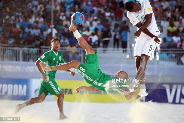 Jair Aleman of Mexico attempts a bicycle kick next to Godspower Igudia of Nigeria during the FIFA Beach Soccer World Cup Bahamas 2017 group B match...