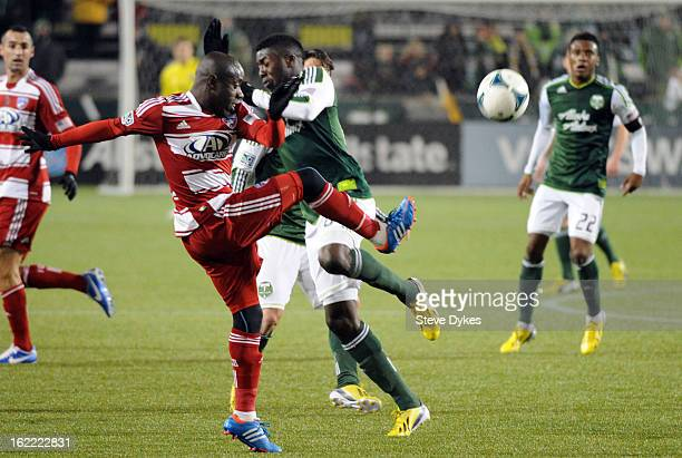 Jair Benitez of FC Dallas and Jose Adolfo Valencia of the Portland Timbers go after a ball during the first half of the game at JeldWen Field on...