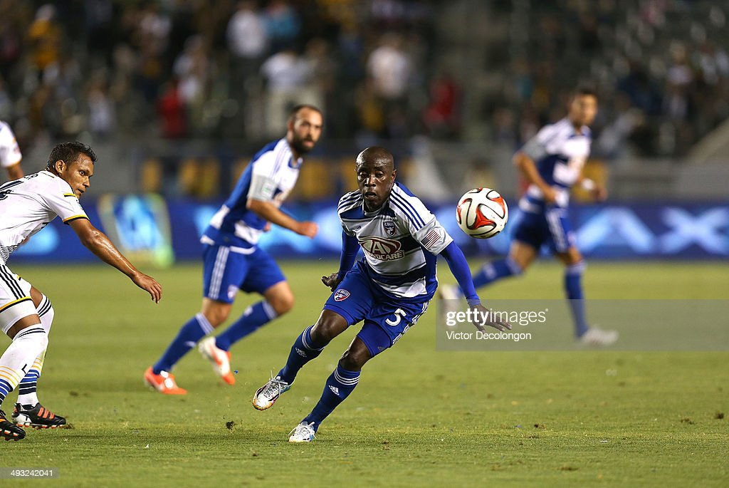 Jair Benitez #5 of FC Dallas plays the ball off his shoulder as Kenney Walker #34 of the Los Angeles Galaxy looks on during the second half of the MLS match against the Los Angeles Galaxy at StubHub Center on May 21, 2014 in Los Angeles, California. The Galaxy defeated FC Dallas 2-1.