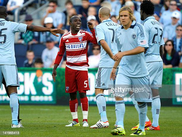 Jair Benitez of the FC Dallas argues with Aurelien Collin of the Sporting Kansas City at Livestrong Sporting Park on March 25 2012 in Kansas City...