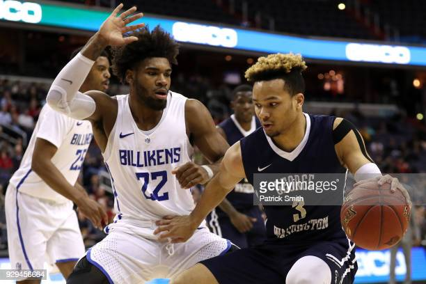 Jair Bolden of the George Washington Colonials is defended by Hasahn French of the Saint Louis Billikens during the first half in the Second Round of...