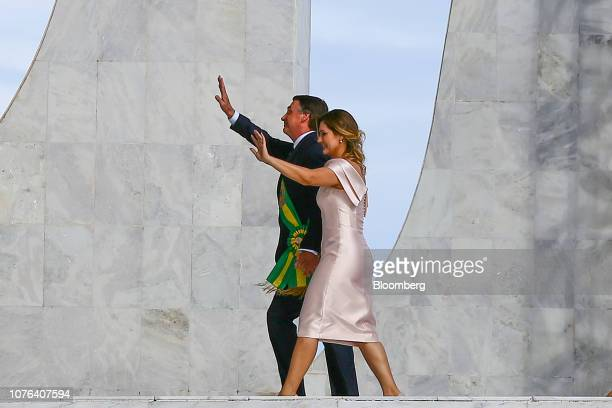 Jair Bolsonaro Brazil's president and Michelle Bolsonaro Brazil's first lady wave to attendees after speaking during the 38th presidential...
