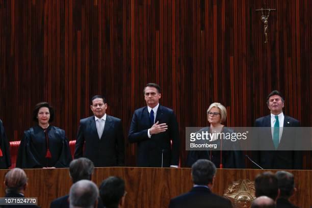 Jair Bolsonaro Brazil's presidentelect center and Hamilton Mourao Brazil's vice presidentelect second left stand for the National Anthem during a...