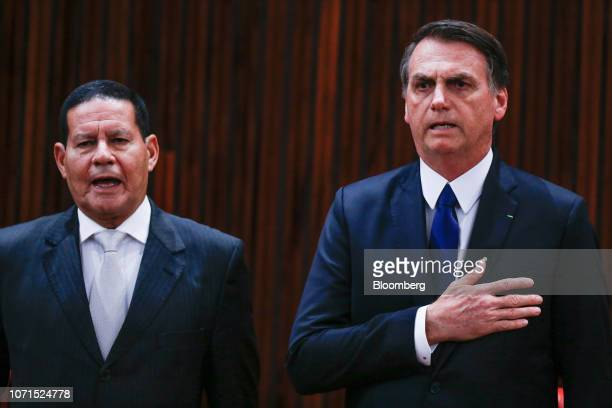 Jair Bolsonaro Brazil's presidentelect right and Hamilton Mourao Brazil's vice presidentelect stand for the National Anthem during a ceremony...