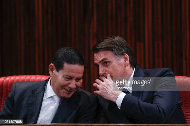 Jair Bolsonaro Brazil's presidentelect right speaks with Hamilton Mourao Brazil's vice presidentelect during a ceremony confirming their election...