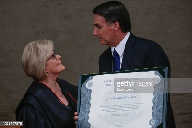 Jair Bolsonaro Brazil's presidentelect right speaks with Justice Rosa Weber chief of the Electoral Supreme Court after receiving a certificate during...
