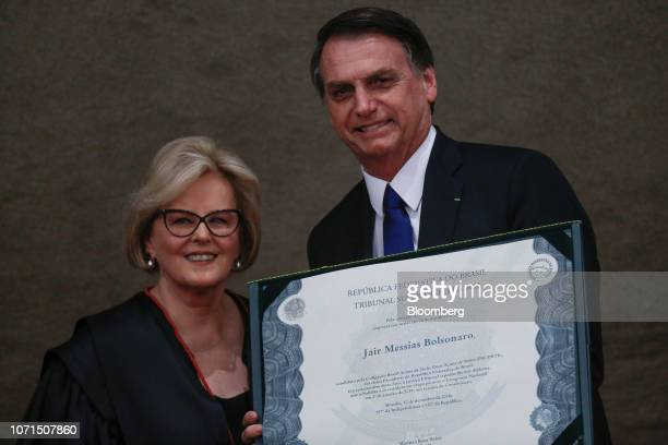 Jair Bolsonaro Brazil's presidentelect right stands for a photograph with Justice Rosa Weber chief of the Electoral Supreme Court after receiving a...