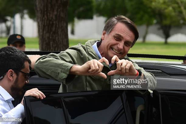 Jair Bolsonaro farright lawmaker and presidential candidate for the Social Liberal Party gestures to supporters during the second round of the...