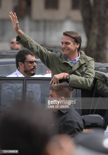Jair Bolsonaro farright lawmaker and presidential candidate for the Social Liberal Party waves to supporters during the second round of the...
