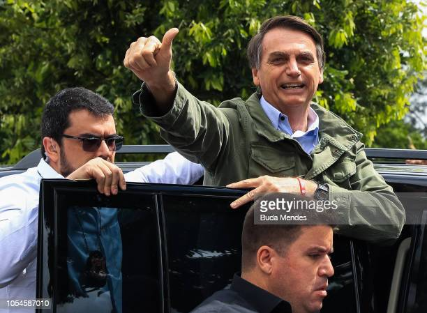 Jair Bolsonaro farright lawmaker and presidential candidate of the Social Liberal Party gestures after casting his vote during general elections on...