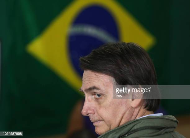Jair Bolsonaro farright lawmaker and presidential candidate of the Social Liberal Party arrives to cast his vote on October 28 2018 in Rio de Janeiro...