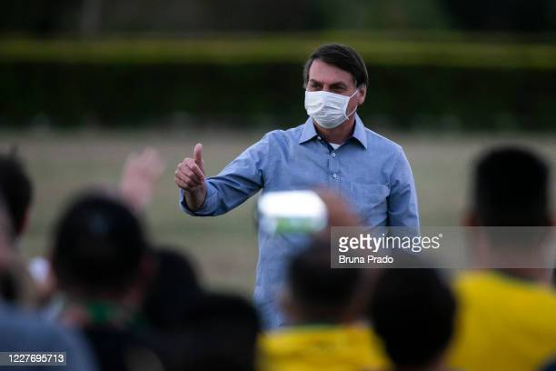 Jair Bolsonaro President of Brazil gestures in front of the official residence after testing positive for coronavirus in Alvorada Palace on July 19...